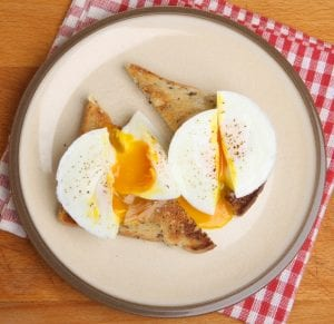 Two poached eggs on wholemeal toast.