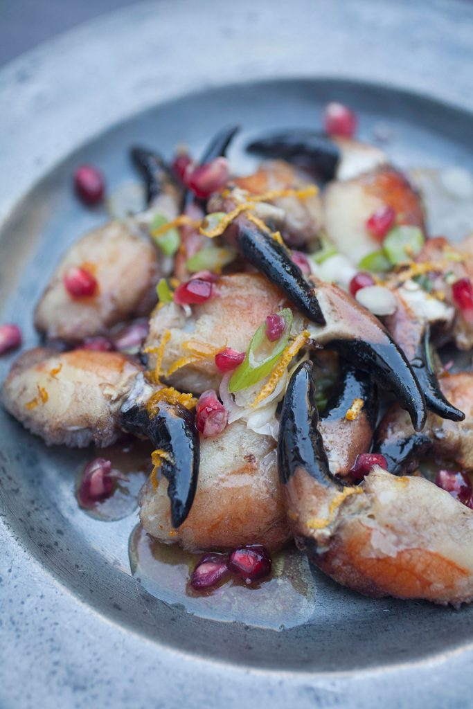 Crab claws with Clementine, pomegranate & rosemary butter