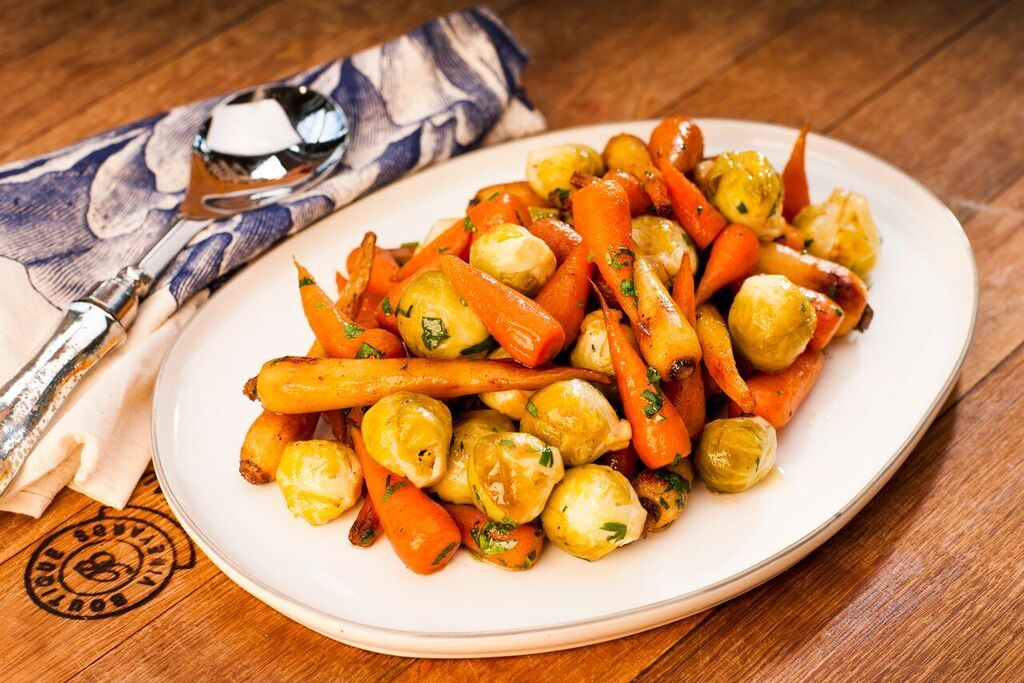 Beef dripping sticky roast parsnips, Chantenay carrots, glazed sprouts & apples